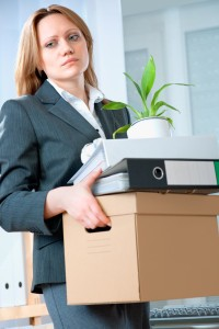 Laid Off Woman Leaving Office with Things