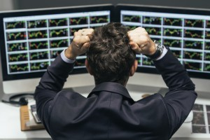 Stock trader tearing out his hair