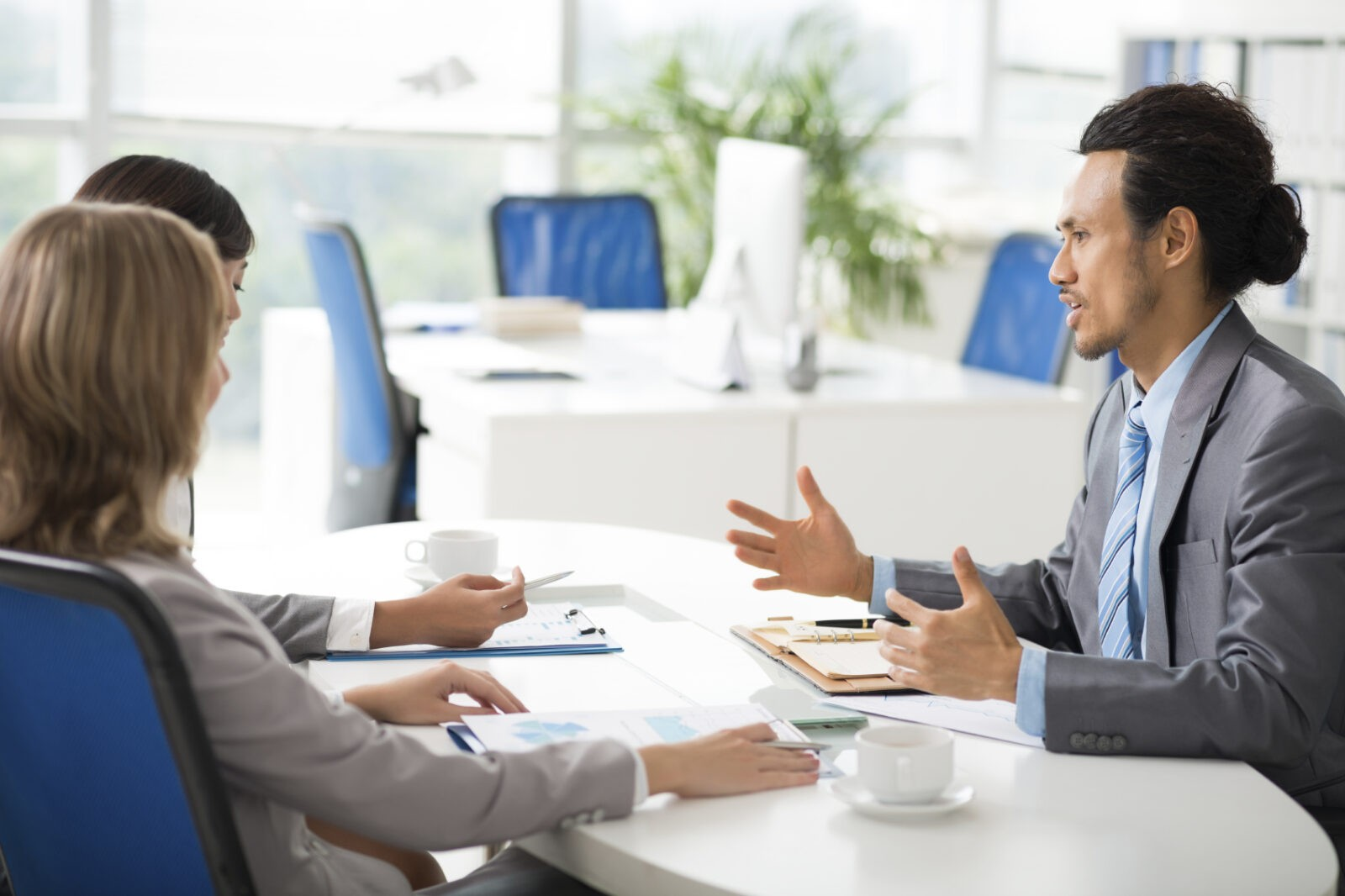 Woman investor listening to report