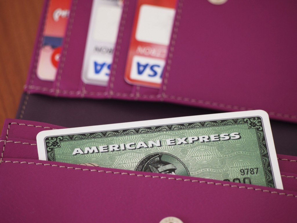 American Express Card inside a wallet with visa cards in background