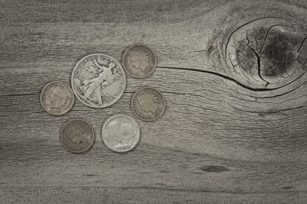 Old United States coins on rustic wood with vintage concept. Layout in horizontal format.